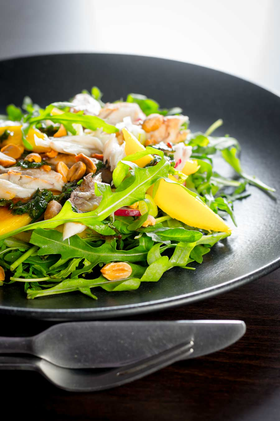 This smoked mackerel salad uses some flavourings from the east combined with mango to cut through the richness and saltiness of the smoked mackerel.