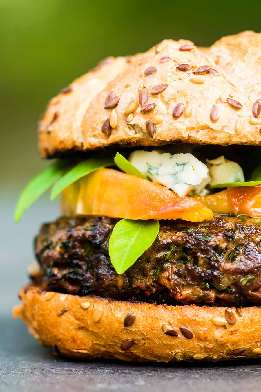 You can't beat a good grilled burger, but there is life beyond beef. This venison burger is topped with gin cooked peaches and blue cheese!