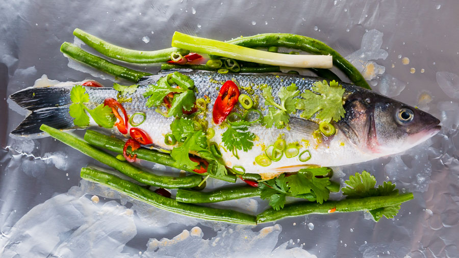 This Asian Fish En Papillote features a classic French technique with bright and vibrant Asian flavours, you cannot beat a whole sea bass cooked on the bone