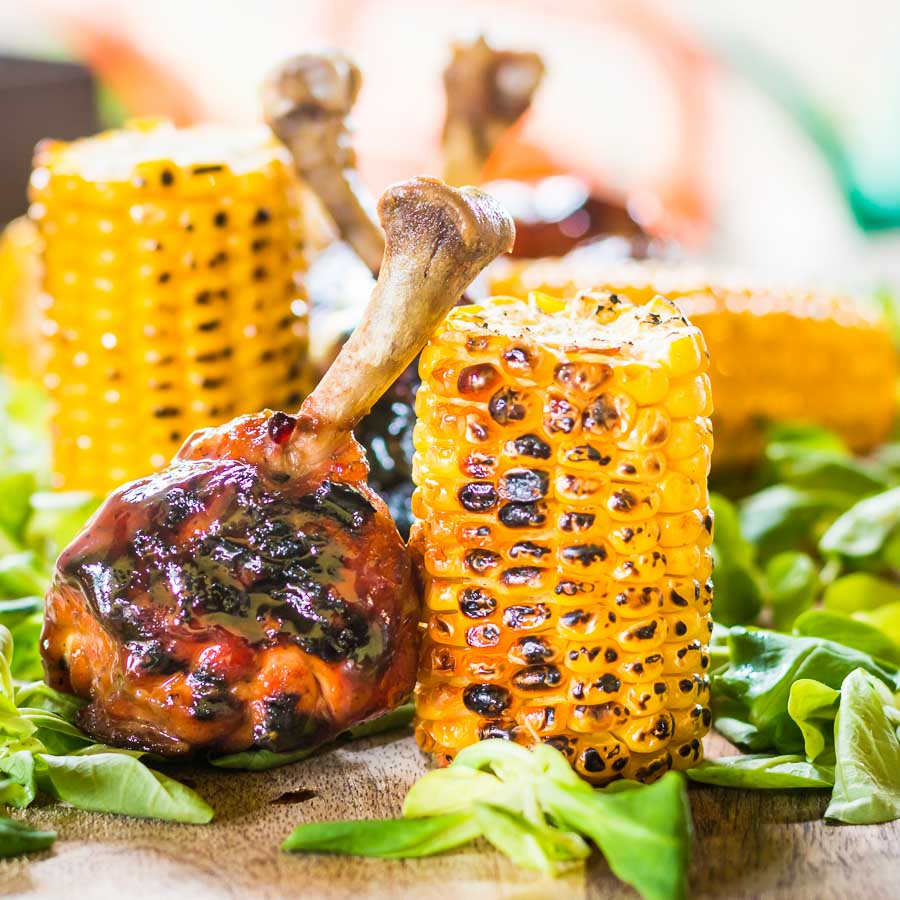 Dark Beer (a porter) and Honey form the base of the glaze on these BBQ chicken drumsticks which are served with simply grilled buttered sweetcorn.