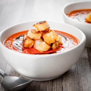 With a little bit of extra effort you can elevate a simple roasted tomato soup to a whole new taste level with hints of thyme and lots of roasted garlic.