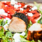 Grilled watermelon is the perfect side for this spicy glazed BBQ pork tenderloin, add a little salty feta cheese and peppery rocket and up your BBQ game!