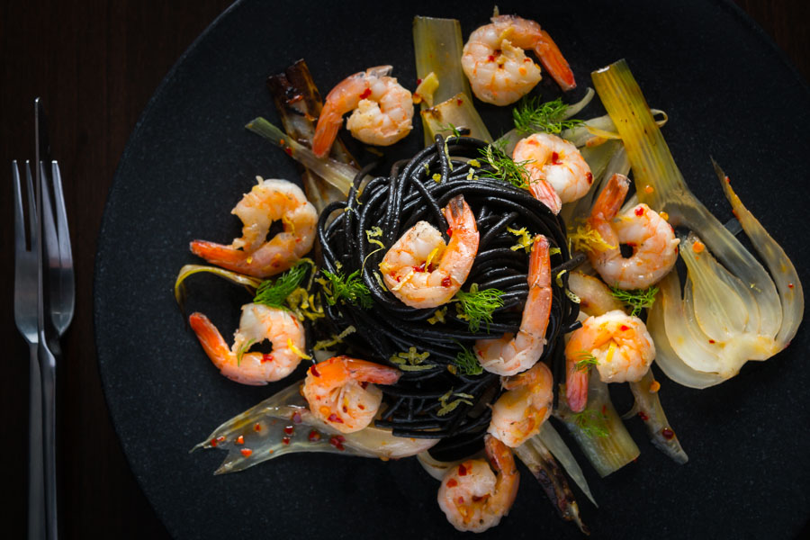 Bring a bit of bling to your spaghetti with shrimp by adding some squid ink pasta and the classics chili, garlic and lemon juice.