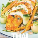 Portrait image of a Thai chicken salad featuring a roasted chicken breast, pickled carrots and cucumber served on a pale green plate with a black rim with text