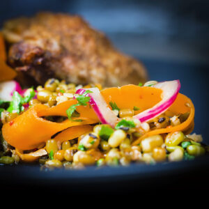 This carrot and mung bean salad is bright and vibrant with the Indian Influenced pickled carrots and served with some simply roasted garam masala chicken thighs.