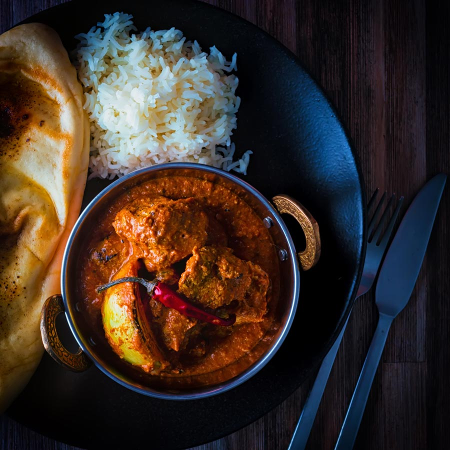 Butter chicken or Murgh Makhani is the classic Indian, grilled chicken in a rich gravy sauce often thickened with nuts and enriched with ghee and in this case sour cream.