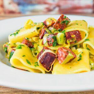 Close up square crop of a salami and leek pasta recipe