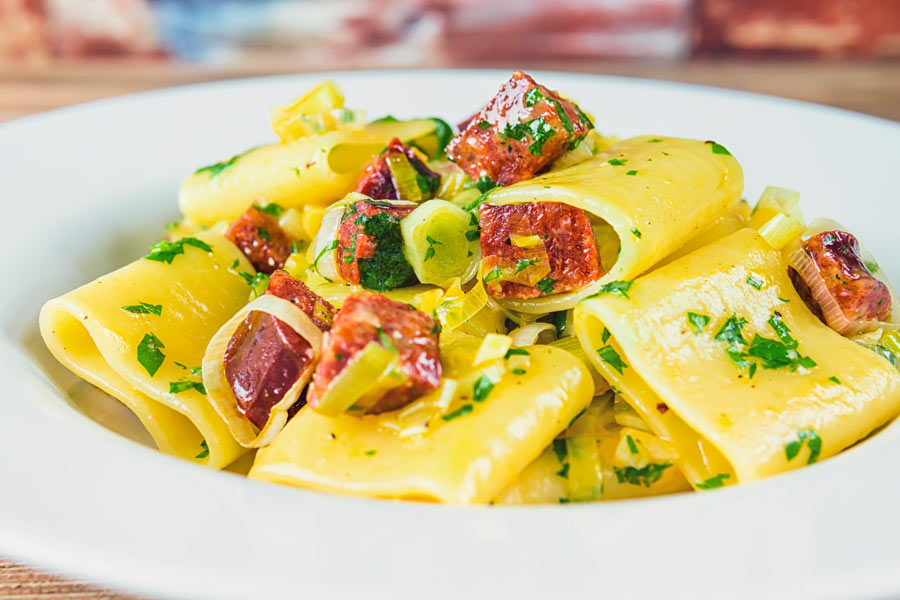 Close up landscape crop of a salami and leek pasta recipe