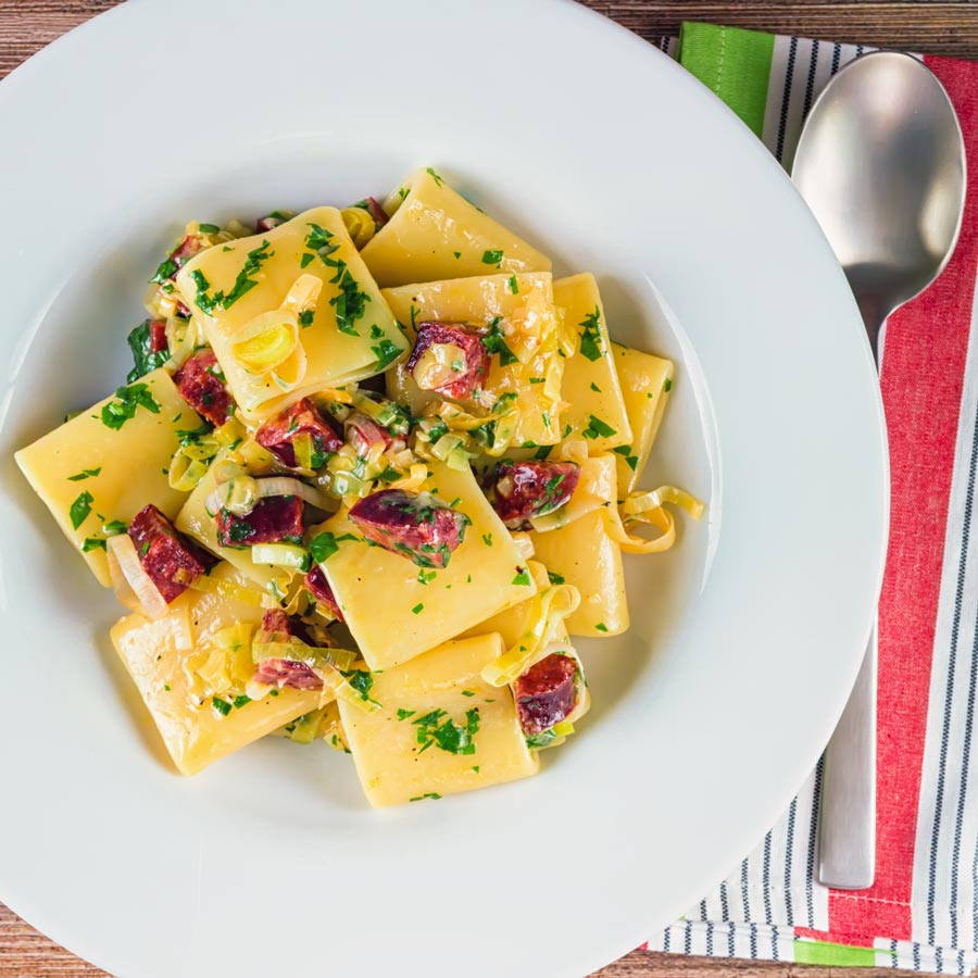 Over head square crop of a salami and leek pasta recipe
