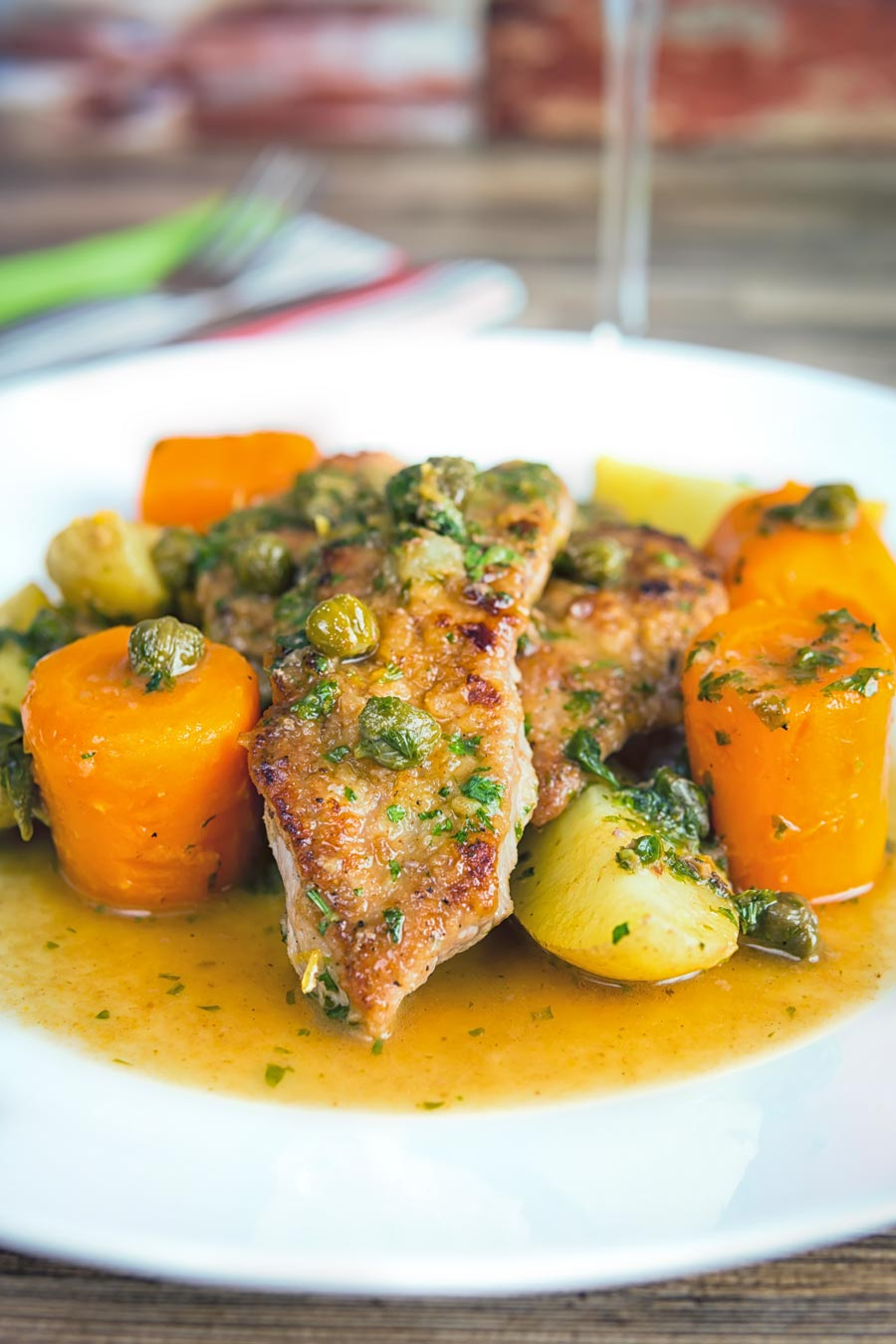 Veal scallopini takes a wonderful piece of veal escalope and combines it with a vibrant wine, caper and lemon sauce to create a delicious simple meal!