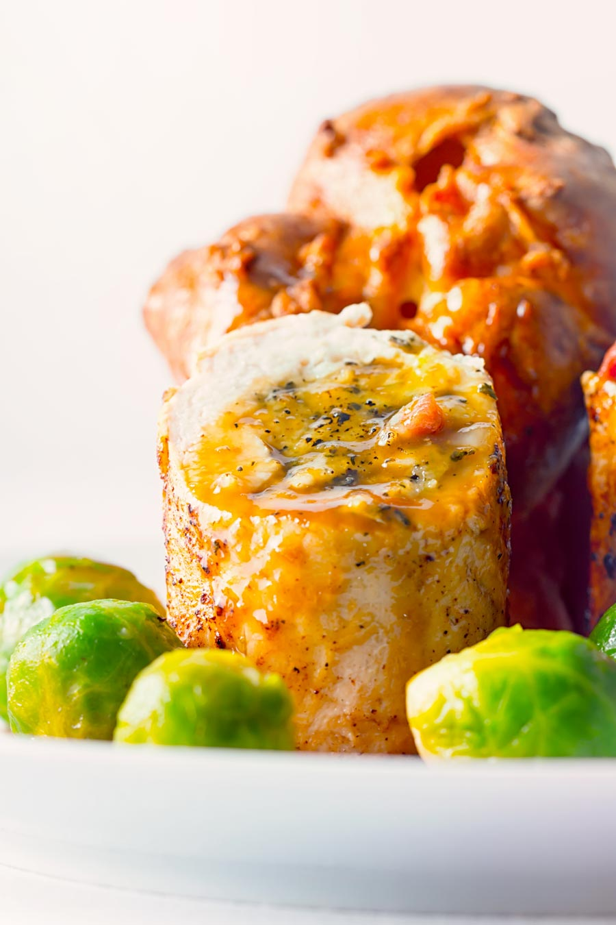 This Poached Sage and Onion Stuffed Chicken Breast recipe and is a lightened up and hurried up take on a traditional British chicken dinner.