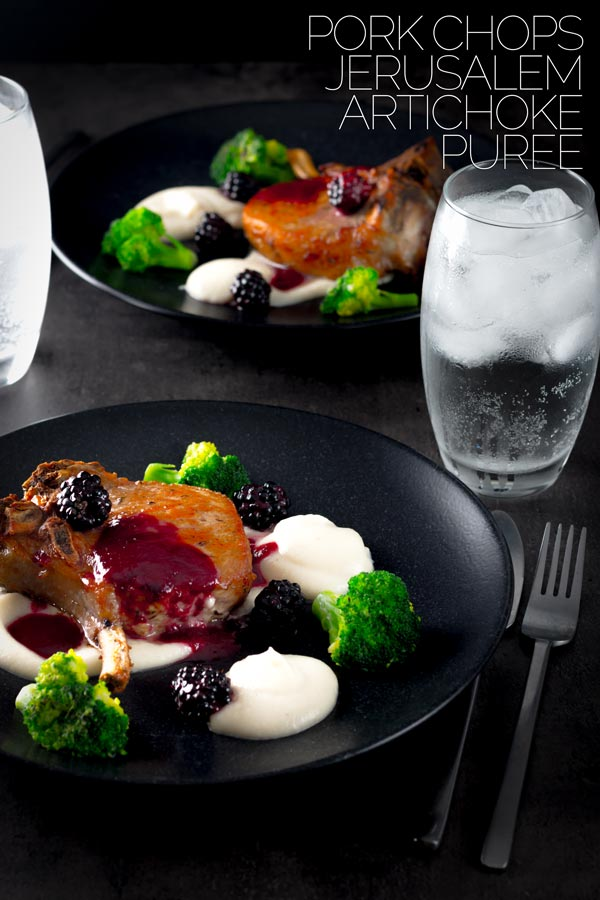These Pork chops are slow baked to keep then lovely and tender they are served alongside a silky Jerusalem artichoke puree with a cider and blackberry sauce on this perfect late summer early autumn dish.  #porkrecipes  #porkchoprecipe