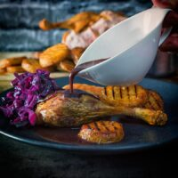 Whole Roast Duck With Scalloped Potatoes and Red Cabbage