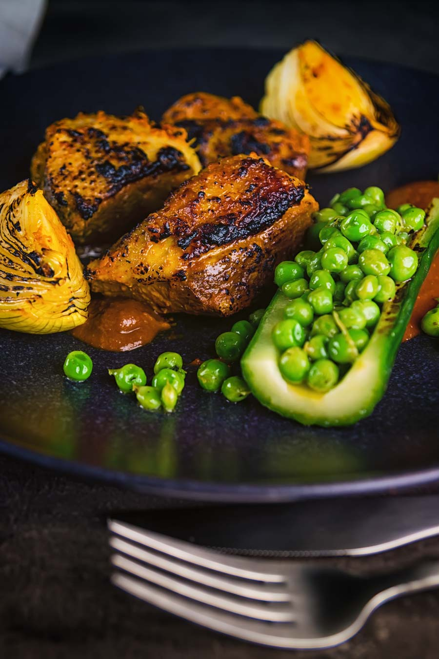 This Indian duck curry is inspired by tikka Masala and features grilled marinaded duck breast with a tamarind and honey sauce, cucumber and peas!