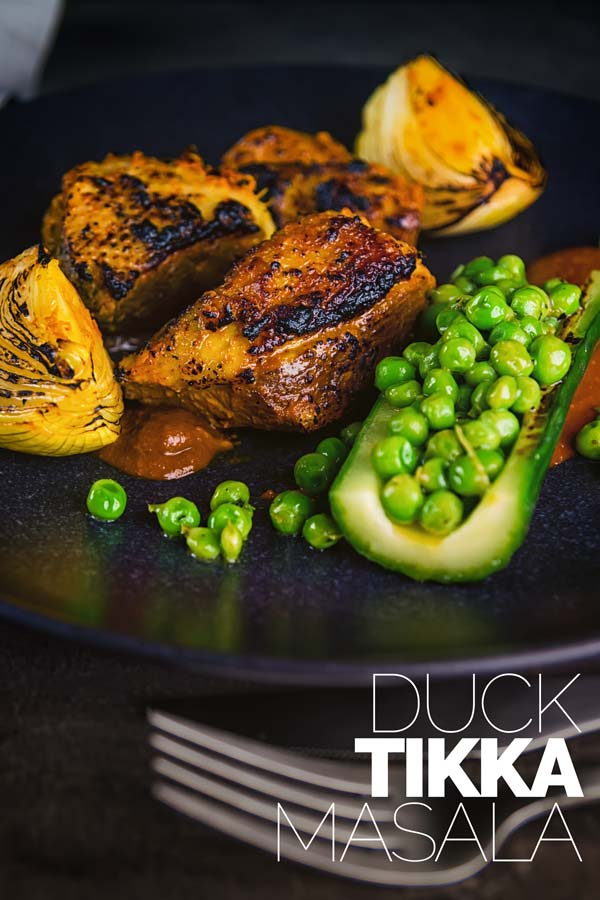 Tikka Masala is a versatile dish that can be meat or vegetarian and is the Grand Daddy of Anglo Indian Curries. This duck curry is my take on a special date night curry dish with beautifully grilled marinated duck breast with a tamarind and honey sauce, cucumber and peas!!  #tikkamasalarecipe #duckbreastrecipes #datenightdinners #dinnerfortwo #duckrecipes  #duckbreastrecipes