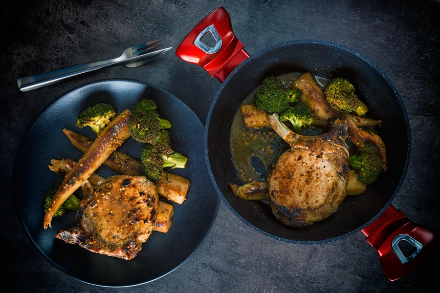 These honey mustard pork chops are baked in the oven together with parsnips and broccoli to create a simple but stunningly tasty complete meal.