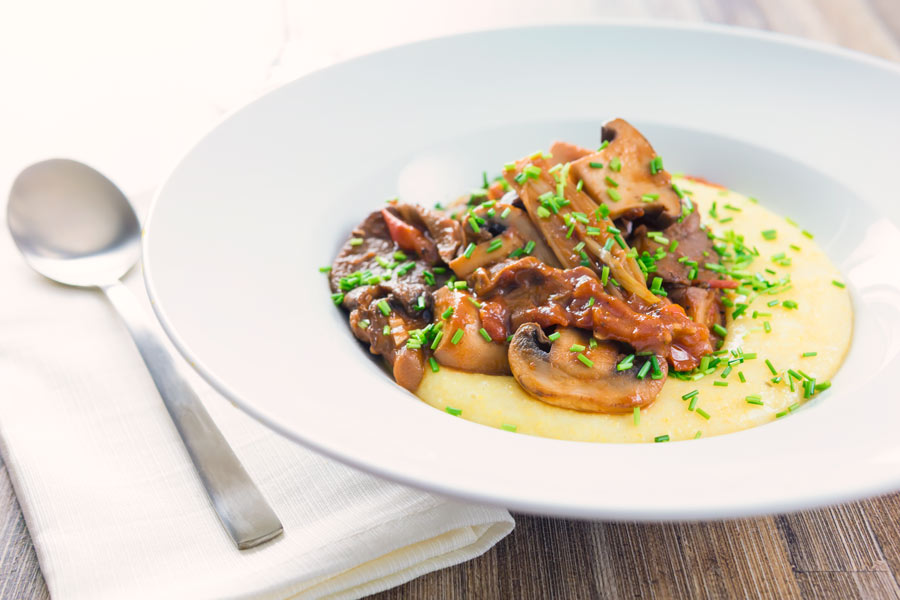 This rich mushroom ragu recipe is the perfect vegetarian meal and is served on a wonderfully comforting cheesy Gruyere polenta.