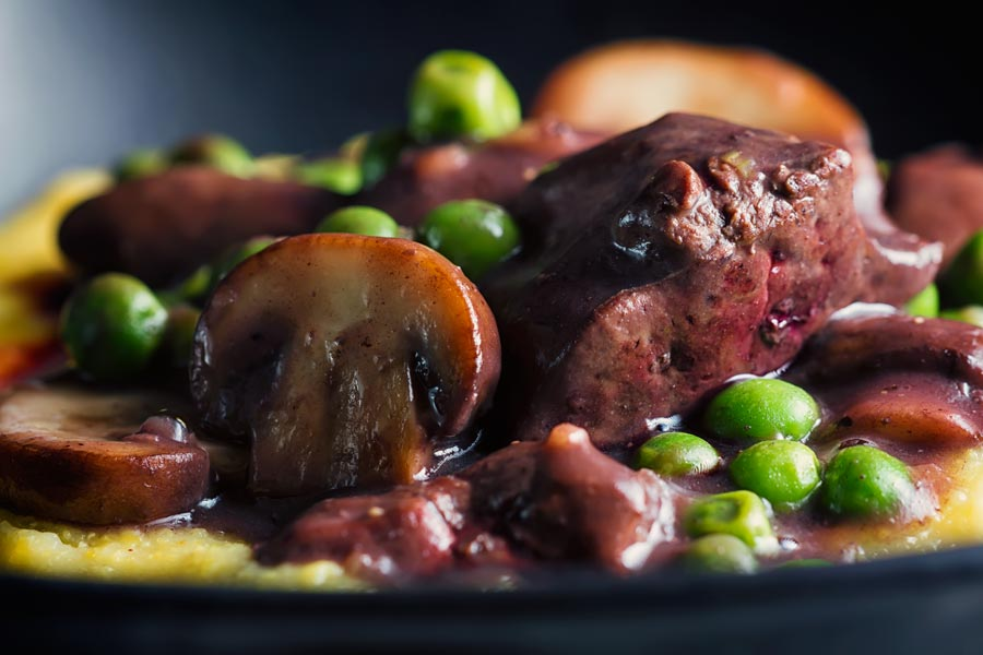I adore cooking with and eating offal, sadly it is not more popular, this chicken liver ragu combines them with peas and mushrooms in a red wine sauce