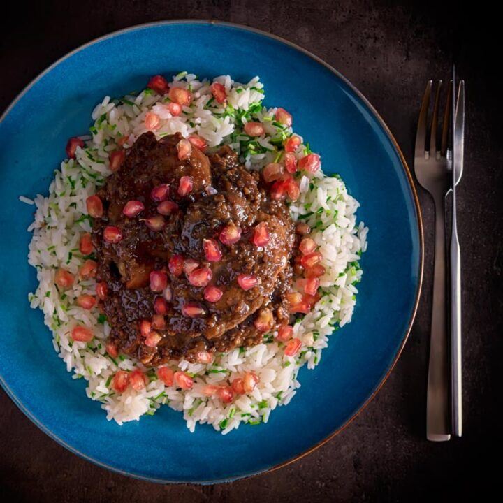 Fesenjan is a simple slow cooked Iranian stew featuring walnuts, pomegranate molasses, onions and chicken thighs that packs a huge punch of flavour.