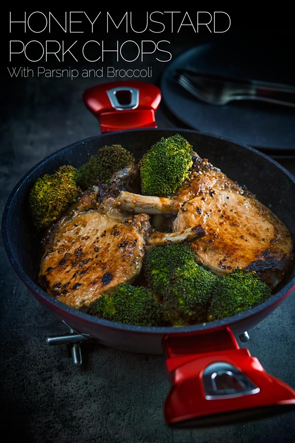 These honey mustard pork chops are baked in the oven together with parsnips and broccoli to create a simple but stunningly tasty complete meal. #porkchops #porkchop #pork #onepot #dinnerfortwo #recipeideas #recipeoftheday