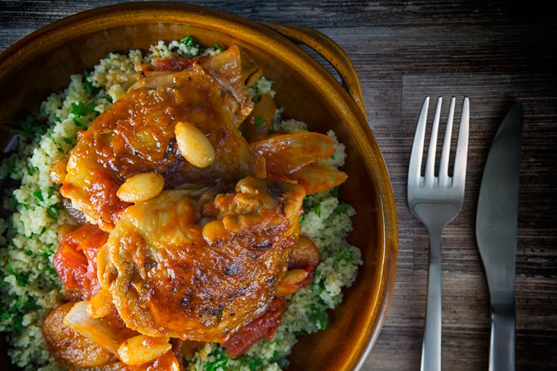 This simple Chicken Tagine recipe makes the most of the great flavour of chicken thighs and features dried apricots, almonds and a host of North African flavours. It is a delicious alternative to a chicken stew!