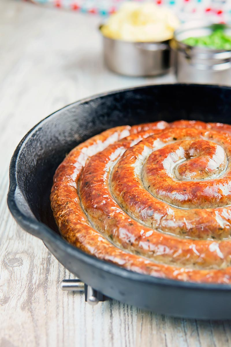 A glorious made from scratch coiled Cumberland Sausage is the star of this very British bangers and mash recipe that also has a kick ass onion gravy!