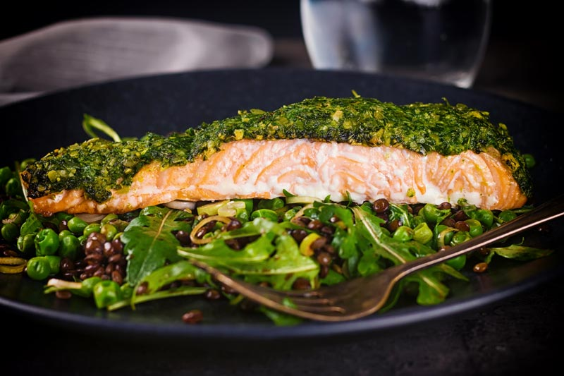 Baked salmon is a beautiful thing and this herb crusted salmon is served with a vibrant green warm lentil salad and a simple but great balsamic dressing.