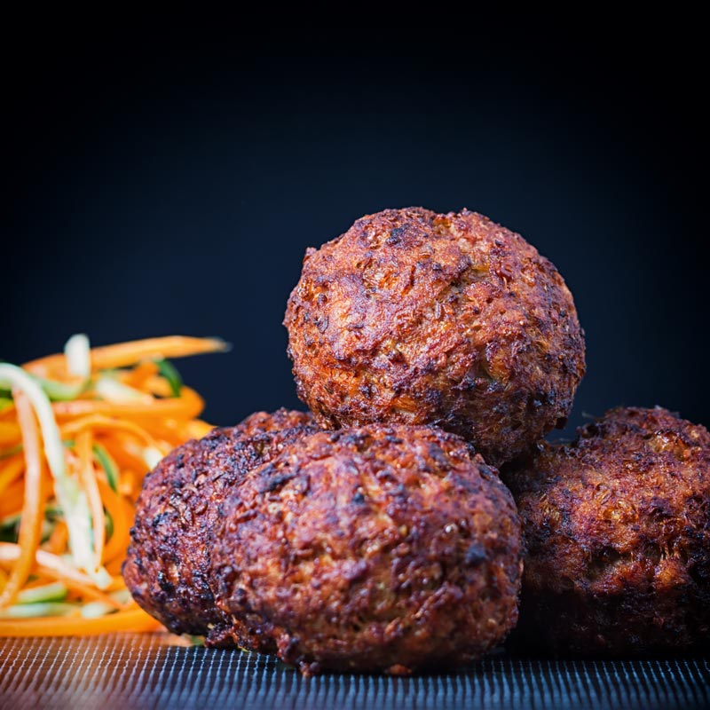 Square image of a Nargis kebab or Indian Scotch Eggs in a pile