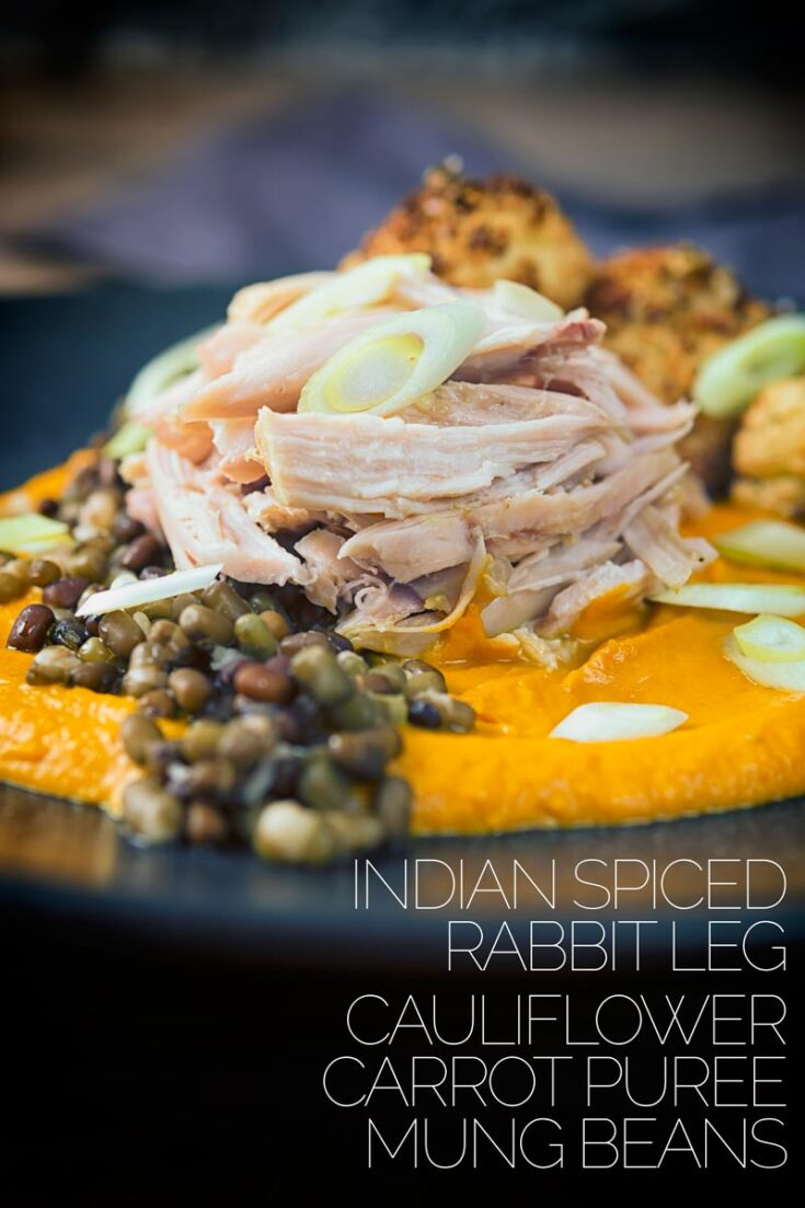 These slow-cooked rabbit legs are poached in an Indian flavoured broth and served with a spicy carrot puree, roasted cauliflower, and mung beans. Many of the parts can be prepared in advance and re heated to make this an easy date night dish. #rabbitrecipes #indianrabbitrecipe #wildmeat #dinnersfortwo #datenightdinnerathome