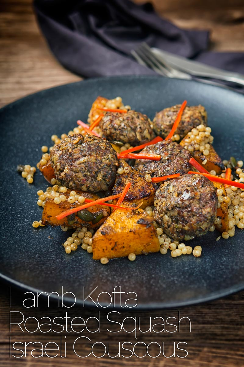 These lamb kofta are meatballs in all but name but are loaded with dried mint, chili and pine nuts and served with squash roasted in pomegranate molasses and zaatar and rounded out with Israeli couscous. #meatballrecipes #groundlambrecipes