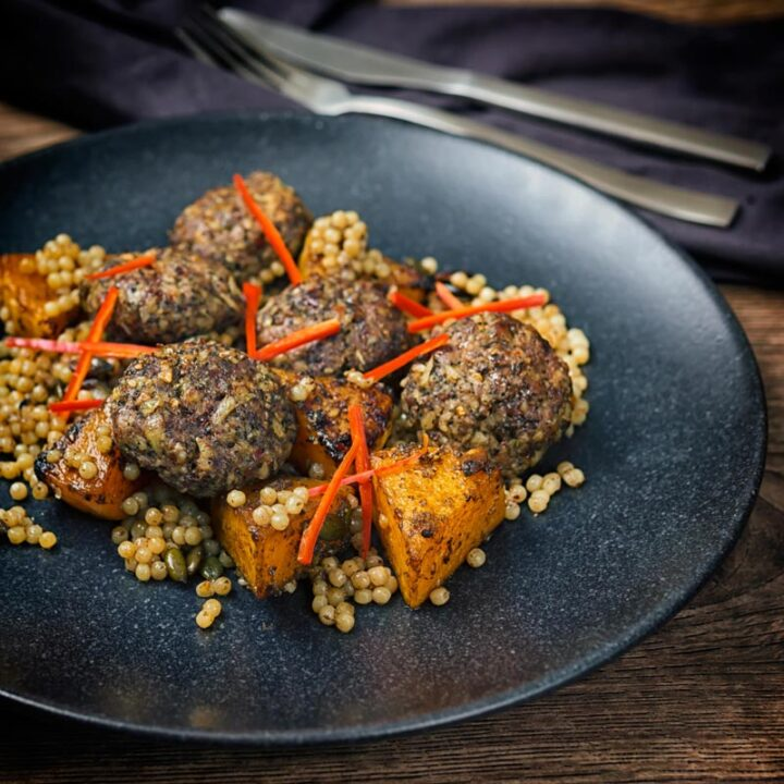 These lamb kofta are meatballs in all but name but are loaded with dried mint, chili and pine nuts and served with squash roasted in pomegranate molasses and zaatar and rounded out with Israeli couscous.