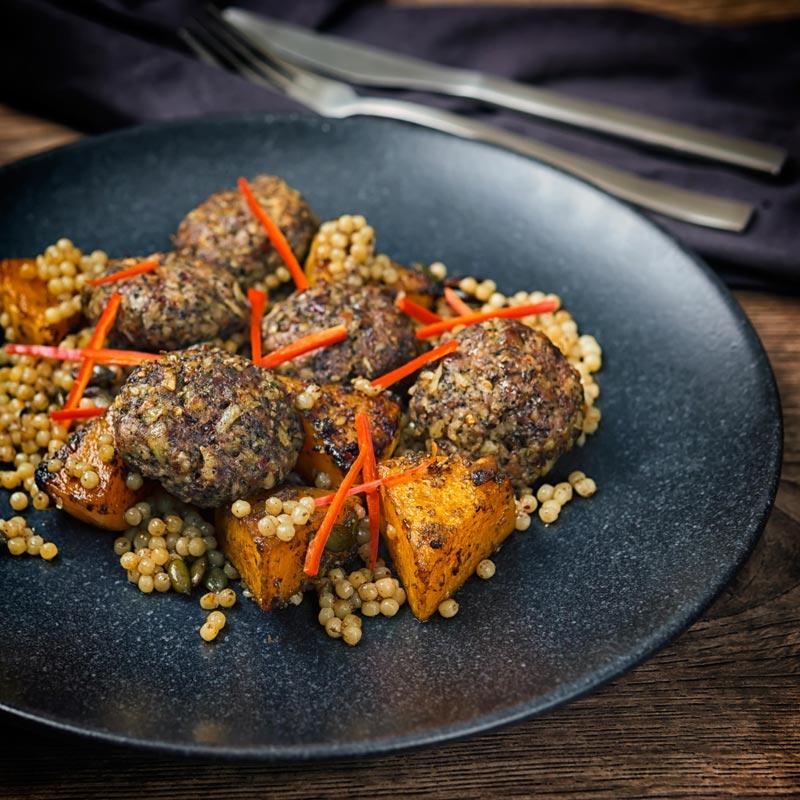 Square image of  Lamb kofta, Israeli couscous and chili batons
