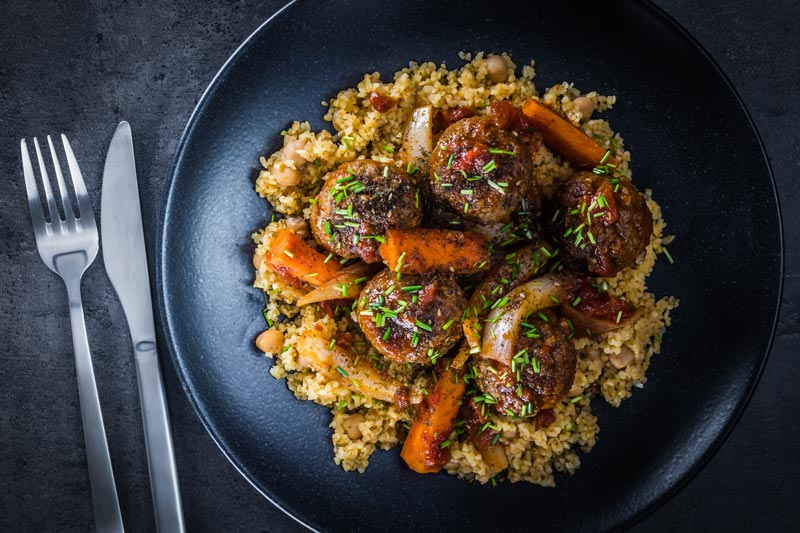 The bed of Harissa spiked bulgur wheat and chickpeas is the perfect bed for these Moroccan inspired beef meatballs, a wonderful winter warmer!