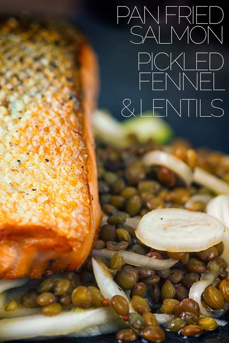 A perfectly pan fried salmon fillet is served on a puy lentil and pickled fennel salad for a perfect mid-week dinner. Why is it a perfect mid-week dinner? Because it is all done in 30 minutes, including the pickling! #30minutemeals #quickeasydinner #fishrecipes #quickpickles #salmonandlentils