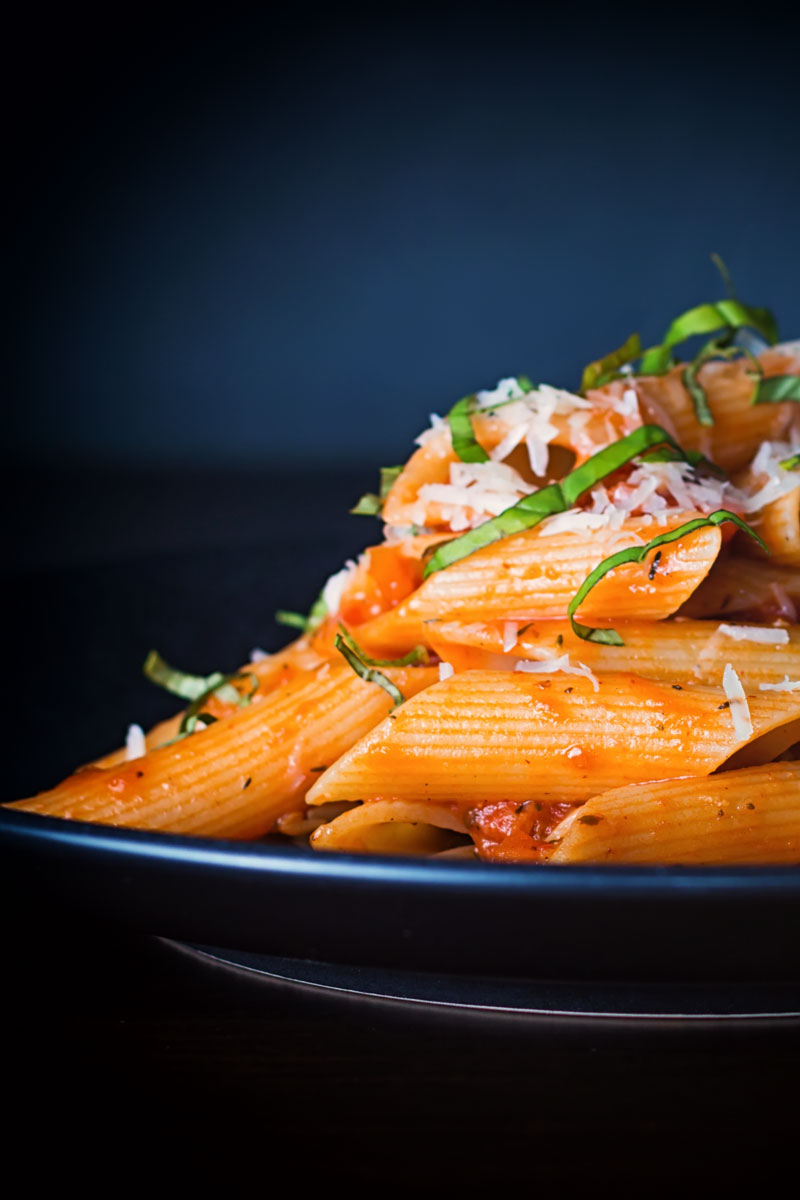 Penne arrabiata is classic pasta dish that is so simple to make and made to sing with fresh basil and a nice kick of chili. A superb tasty easy week night meal in less than 30 minutes!