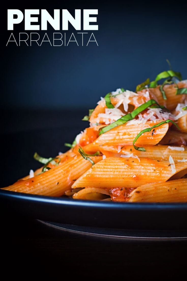 Penne arrabiata is classic pasta dish that is so simple to make and made to sing with fresh basil and a nice kick of chili. A superb tasty easy week night meal in less than 30 minutes! #simplepastarecipes #spicypastarecipes #30minutemeals #dinnersfortwo #vegetarianmeals #easypastarecipes