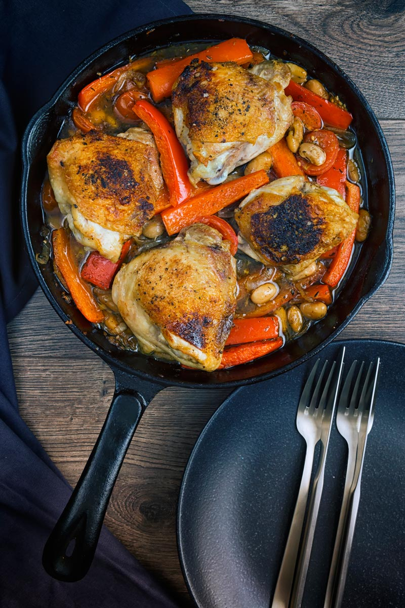 A chicken stew loaded with red peppers and beans and flavoured with Balsamic vinegar all cooked in one pot or skillet making it the perfect midweek dinner.