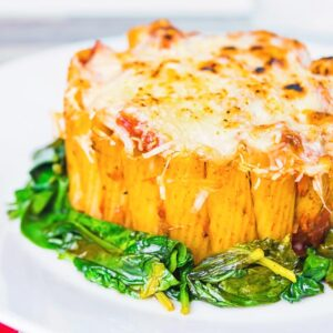 Yes, I know it is not really a pie, but hey it is my rigatoni pasta pie… Rigatoni standing to attention with a balsamic tomato sauce, mozzarella and Parmesan and wilted spinach!