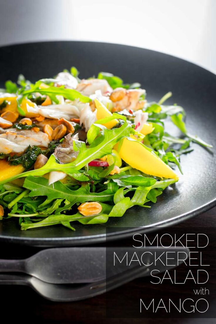 This smoked mackerel salad uses some flavourings from the east combined with mango to cut through the richness and saltiness of the smoked mackerel adding an extra crunch with some roasted peanuts. #saladideas #fishsalad #healthymackerelrecipe #dinnersfortwo