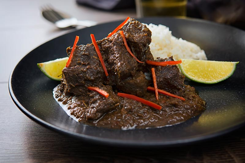 Beef rendang is a spicy hot stew or curry type of dish from Indonesia, typified by a hot and sour flavour my version is a closer to a kalio or a 'wet' rendang. This means we get a little more sauce than traditional rendang which is cooked on even longer.