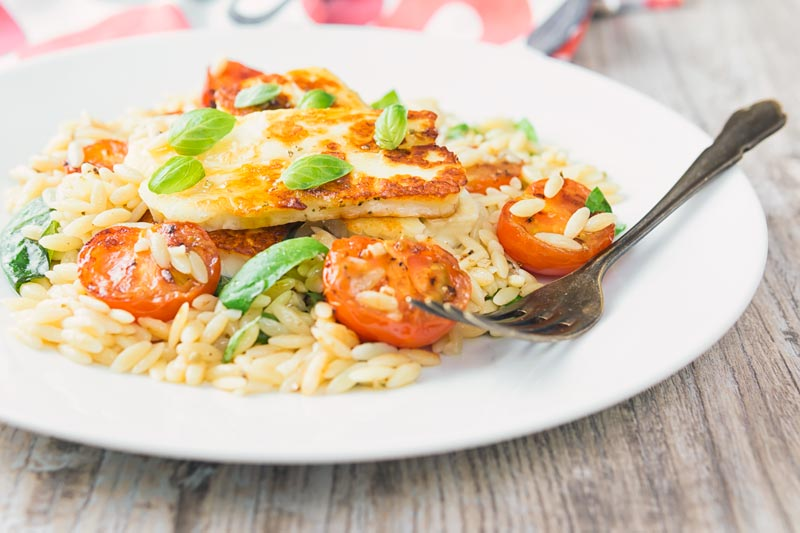 This super simple Orzo salad is both light and filling, featuring classic Mediterranean flavours like balsamic, tomato and basil it is topped with seared Halloumi cheese. The kicker is it is all done and dusted in less than 30 minutes!