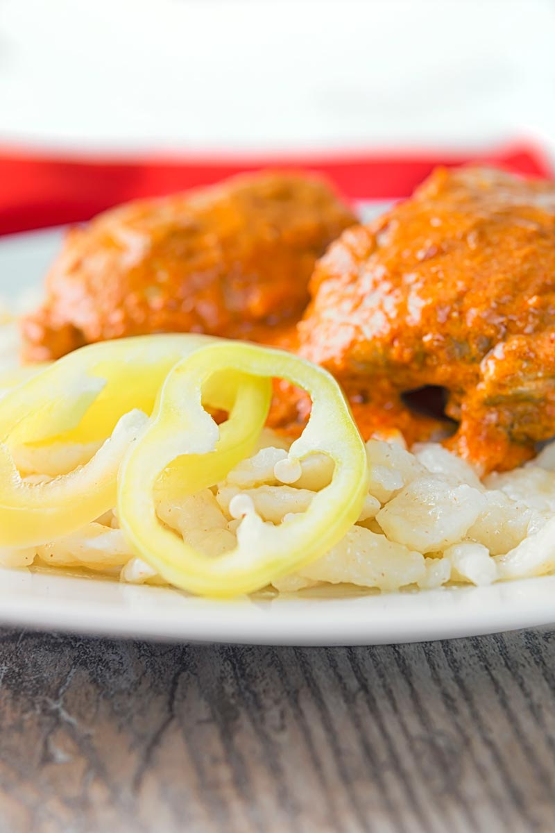 Hungarian Chicken Paprikash with Homemade Nokedli, moist chicken thighs in a velvety sweet paprika rich sauce served with fresh nokedli or dumplings