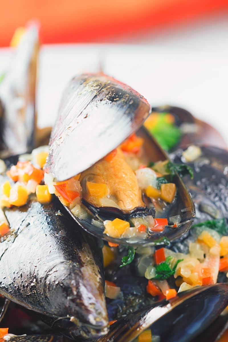 Close up of a pile of beer steamed mussels