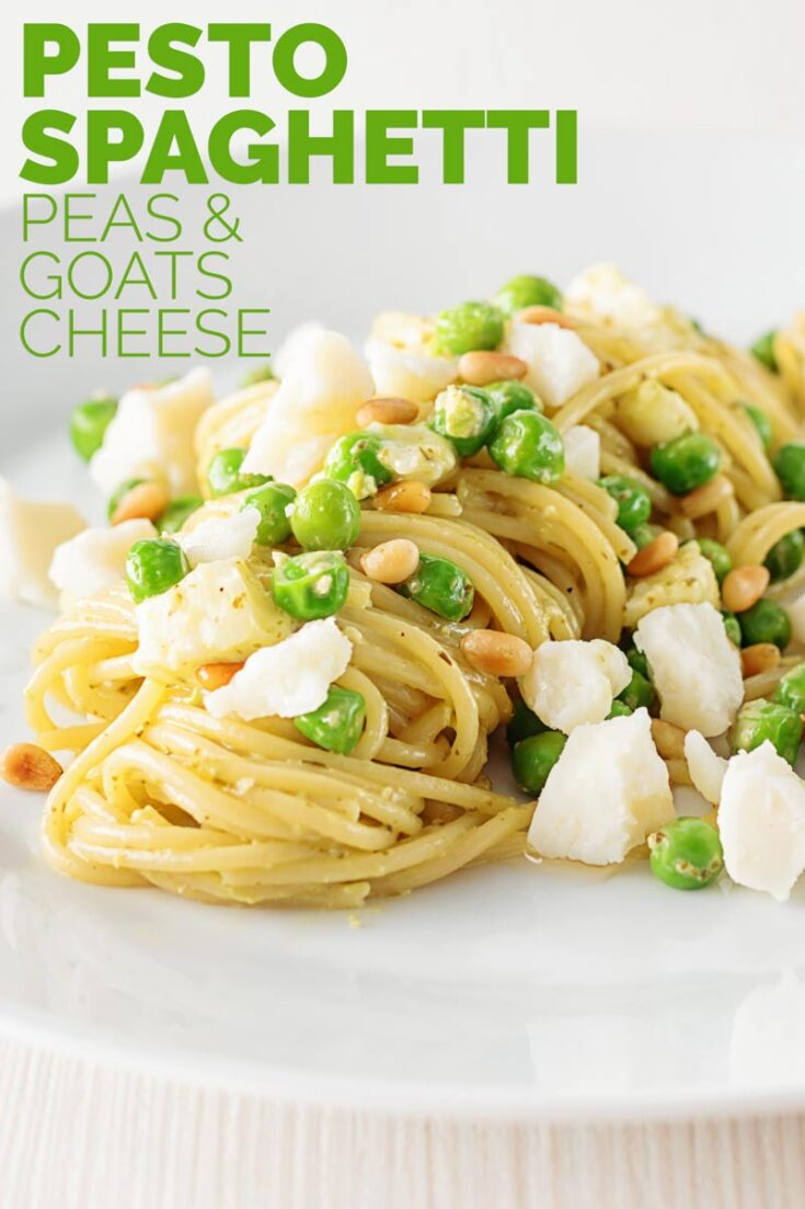 Pesto spaghetti is given a new breath of life with some peas, goats cheese and some extra pine nuts, to make a quick pasta dinner. #italianfood #italianrecipes