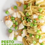 Pesto spaghetti is given a new breath of life with some peas, goats cheese and some extra pine nuts, to make a quick pasta dinner.