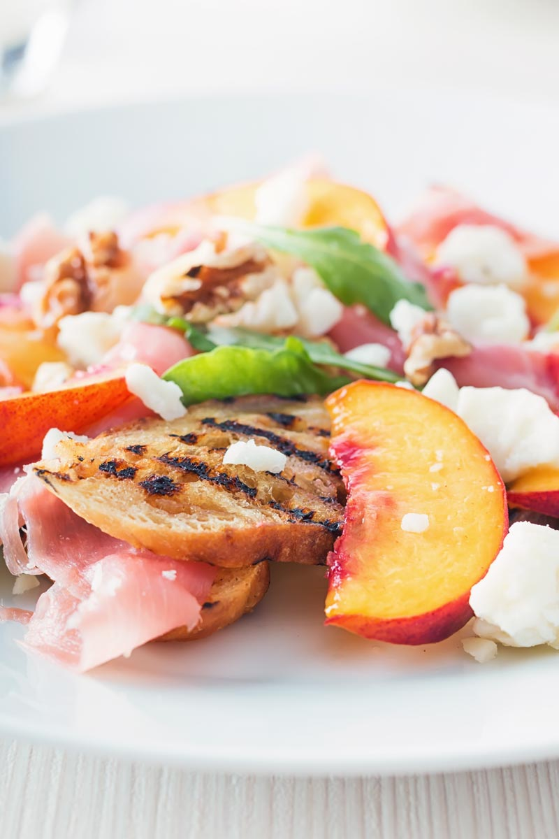 Pickled peaches and griddled bread in a  ham and cheese salad