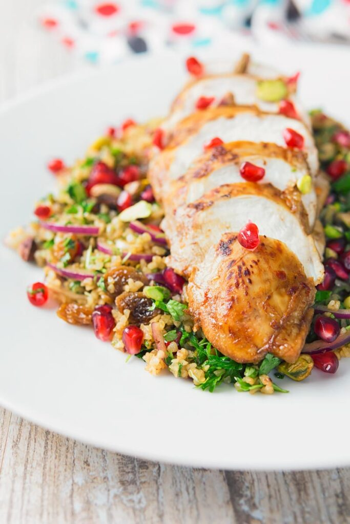This pomegranate chicken breast is mariunaded for up to two days and them served on a vibrant bed of bulgur wheat stuffed full of glorious flavour!