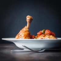 Roasted Chicken Leg with Tomato Capers and Polenta