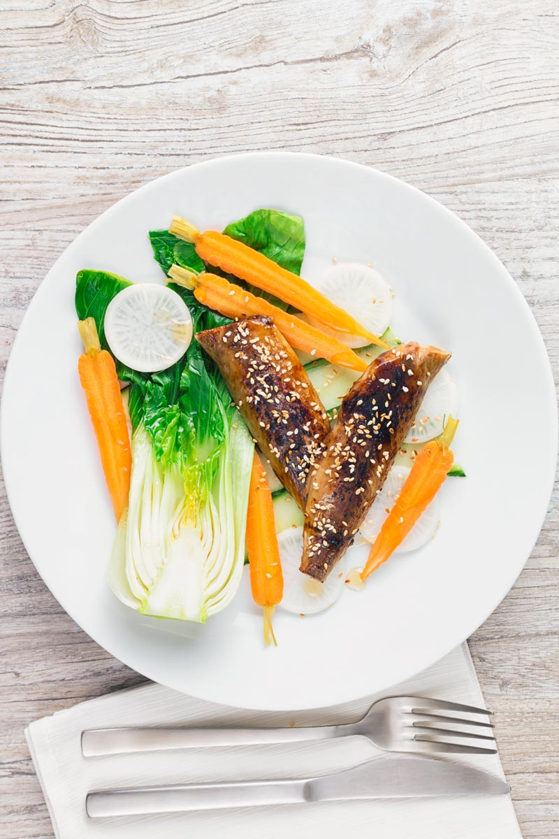 Blow torched Smoked mackerel fillets featuring in a smoked mackerel salad with pickled carrots, radish and blanched bok choi.