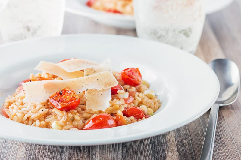 Tomatoes are a main stay of Italian food but a tomato risotto remains something of an unusual dish but a real favourite of mine! It's a perfect vegetarian week night meal… ready in less than an hour!